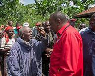 File photo- President Uhuru in a light moment with an elderly man who is under the inua jamii programme