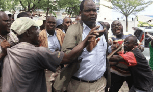 Miguna Miguna being roughed up by an angry mob