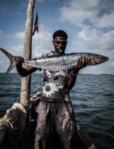 A good catch. A Kenyan fisher man displays a huge fish. Kenyan fisher men have been facing competition from illegal fisher men