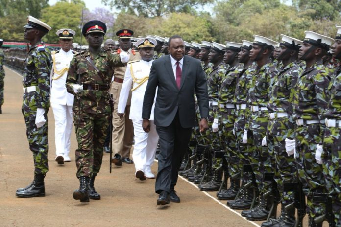 File photp- president Kenya inspects a gurad of honour parade during a recent pass out ceremony for recruits