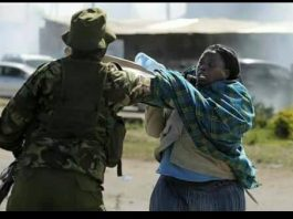 An udated photograph of a police officer assaulting a helpless woman