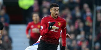 Manchester United's striker, Lingard, dribbles past a Crystal Palace player. Manchester United drew 0-0 with the visitors at Old trafford