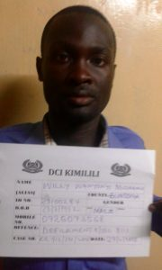 Mr. Willy Wanyoni of Moi Girls Kamusinga after his arrest for defiling a student at the school