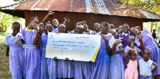 Obambo primary school pupils in ecstatic mood after receiving sponsorship from Kenya Power's 'Wezesha Jamii' programme