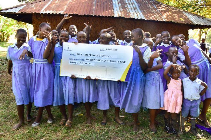 Obambo primary school pupils in ecstatic mood after receiving sponsorship from Kenya Power's 'Wezesha Jamii' programme