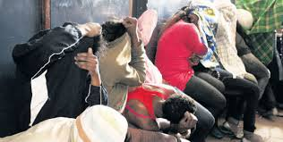 Photo (Courtesy)- Some of the arrested students in Bomet engaging in alcohol drinking and sex party.