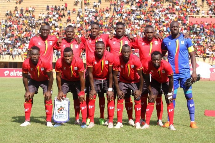 Uganda' soccer team, the Cranes, pose for a group photo during an international match. They are ranked top in the CECAFA region