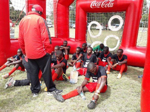 Kenya's Under 16 Boys' Soccer team receive tips from their tacticians at the half time break during their semi final clash against Zambia today. Kenya won 1-0