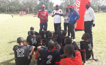 Kenya's Under 16 Boys soccer team take a rest during the half time break during their Quarter finals clash of the Copa Coca Cola Africa Championship today, kenya defeated Uganda 1-0 to book a semis clash.jpg