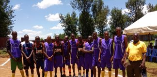 Biticha Secondary's boys basketball team pose for a group photo before facing Omonayo Secondary, today. Biticha won the match by a 30- 24 margin.