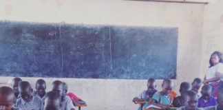 Photo- Grade three children using digital devices for a math lesson at Kabulokorr primary school in Loima Turkana County.