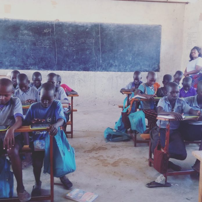 Photo- Grade three children using digital devices for a math lesson at Kabulokorr primary school in Loima Turkana County.