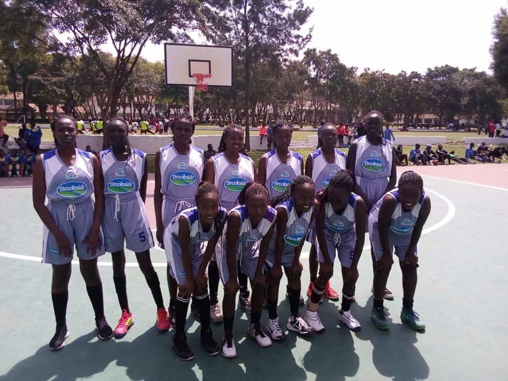 Kenya's Girls basketball champions, Buruburu, pose for a group photo after overcoming Rwanda's LDK 43-42 in a tough match played at St. Constantine in Arusha, Tanzania, today