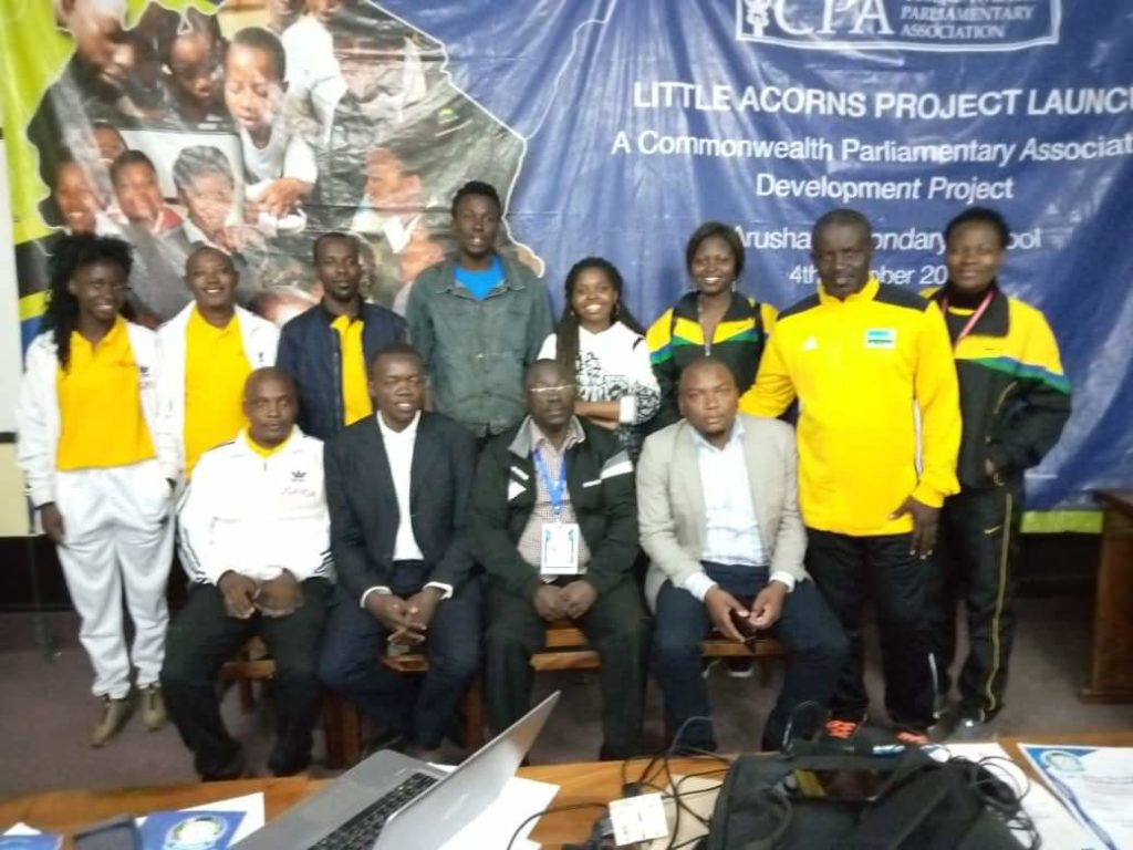 The FEASSSA Secretariat Team after concluding their work in the 2019 games in Arusha, Tanzania (Seated Centre; in specs, is Mr. George Omondi the FEASSSA Vice Secretary General).