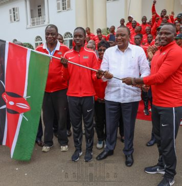 President Kenyatta when he handed the Kenyan team national flag at State House, Nairobi on Monday August 19, 2019. He wished the Kenyan contingent success at 12th African Games in Morocco.