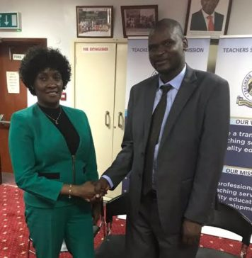 Mr. Eric Ademba, right, winner of the 2019 edition of the African Union Continental Teacher Award is congratulated by the TSC boss, Dr. Nancy Macharia. Photo/ File.