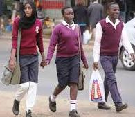 Learners walk home after schools were closed due to the outbreak of Covid-19 pandemic. The government is finding itaself within a hard place and a rock on making a decision whether to reopen schools soon or not.