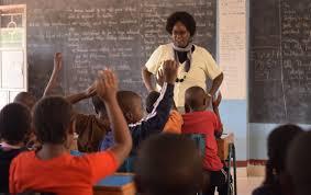 A TSC teacher in class.
